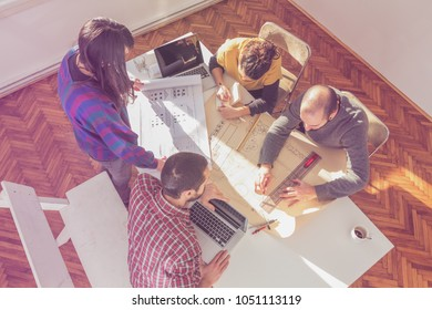 Group of young architects in the sunny office.