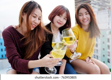 Group of young asia women drinking at rooptop party, friends holiday celebration party concept