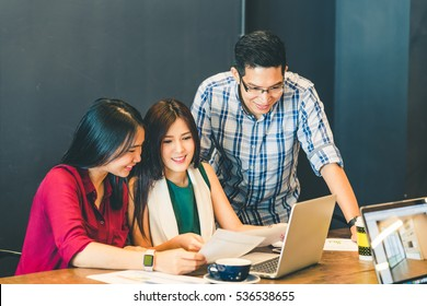 Group of young Asian business colleagues or college students in team casual discussion, startup project business meeting or happy teamwork brainstorm concept, with copy space, depth of field effect