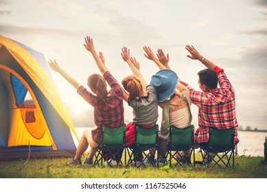 Group of Young Asian Camper Enjoy Camping Outdoors Party with Friends Near the Lake in the Forest -  Travel in Summer Holiday Concept