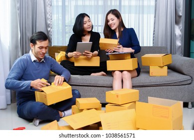 Group of young Asian small business owner at home office, online marketing packaging box, prepare for delivery, and checking orders.