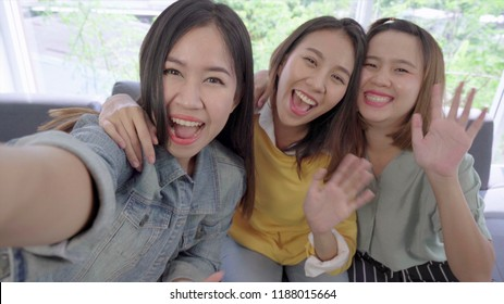 group of young Asian women friends having fun looking and say hi at the camera