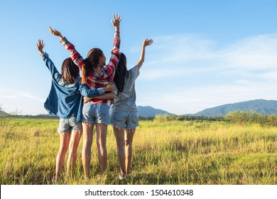 Group of young Asian women having fun and happy on summer holiday vacation in evening. Friendship lifestyle and traveling concept.