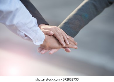Group of young business man and woman united hands together with spirit teamwork for win-win situation with flare technique - success teamwork concepts or collaboration concepts.
