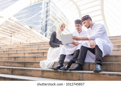 Group of young business muslim man and women using laptop contact with partner at outdoor meeting, Muslim businessman and businesswoman success concept, business people co-working teamwork concept