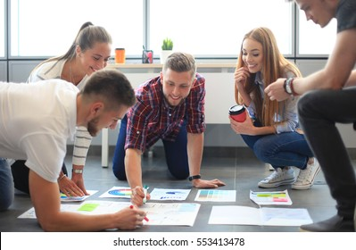 Group of young business people and designers.They working on new project.Startup concept.