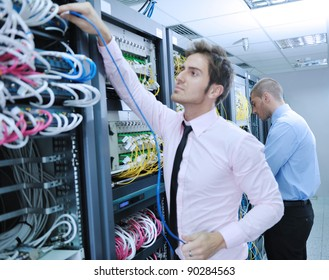 group of young business people it engineer in network server room solving problems and give help and support