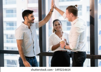 group of young business people giving high five in office . Meeting Greeting .