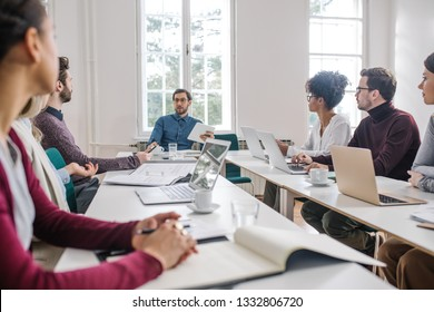 Group of young business people having a meeting at the modern office space.