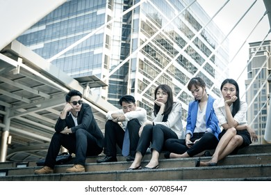 Group of young business people in modern city, bored with hard work, people and crisis concept.