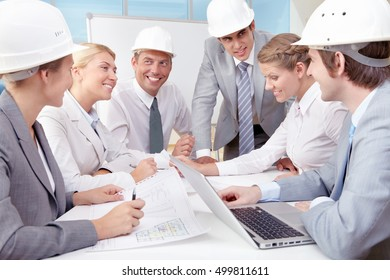 Group of young business people sitting at the table and discussing
