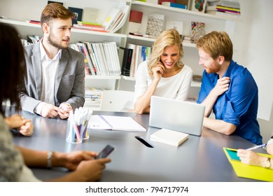 Group of young business people sitting on modern office