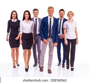 A group of young business people smiling on a white background. Studio shooting
