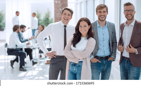 group of young business people standing in the office