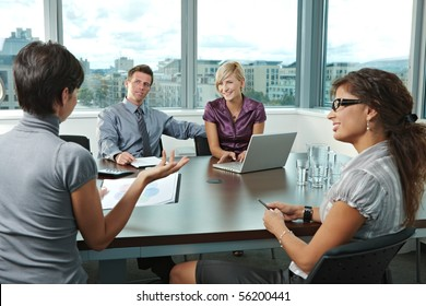 Group of young business people talking on business meeting at office.