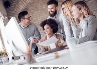 Group of young business people working together in office.Startup,freelance and business concept.