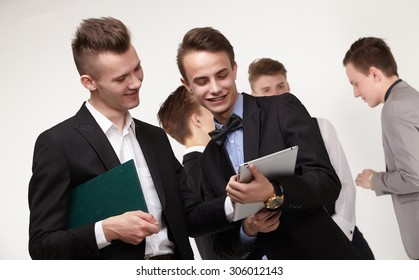 a group of young businessmen looking at paperwork