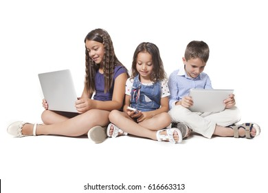 Group of young caucasian children are using devices