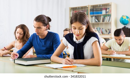 Group of young caucasian students studying in the classroom