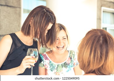 Group of young cheerful women friends laughing during bachelorette party in cafe in bright sunny day with warm light concept fun happiness