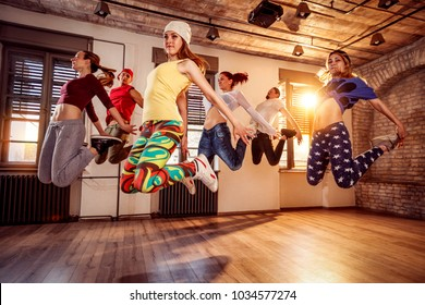 Group of young dancer people jumping during music