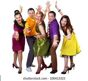 group of young dancing people in bright colour wear