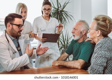 Group of young doctor during home visit senior people