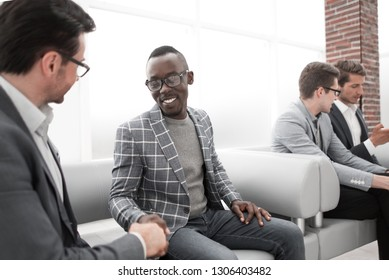 group of young employees are waiting for an interview in the office lobby