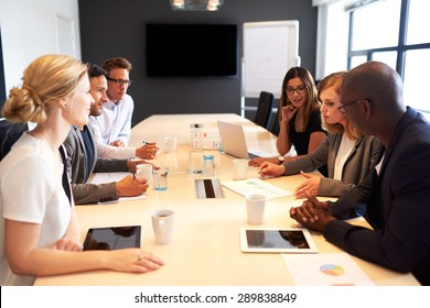 Group of young executives holding a work meeting in a conference room