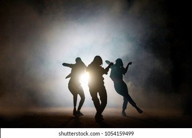 Group of young female dancers on the street at night. common interests. favourite pastime. dancing together