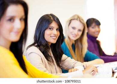 group of young female university students in classroom