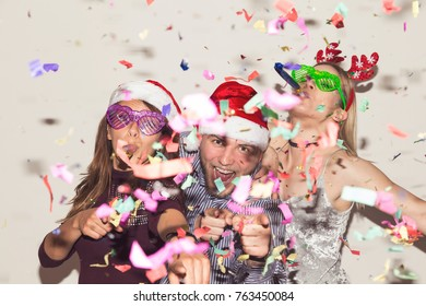 Group of young friends dancing and having fun at New Year's Eve party