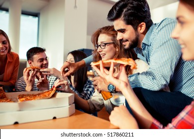 Group of young friends eating pizza.Home party.