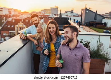 Group of young friends having fun at the rooftop