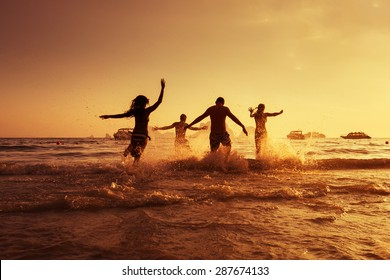 Group of young friends having fun on the beach