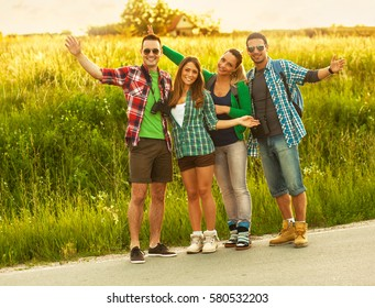 Group of young friends hiking on beautiful summer day.