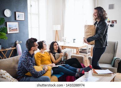 A group of young friends indoors at home, house sharing concept.