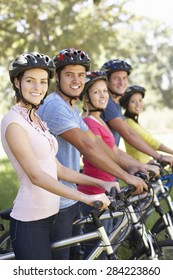 Group Of Young Friends On Cycle Ride In Countryside