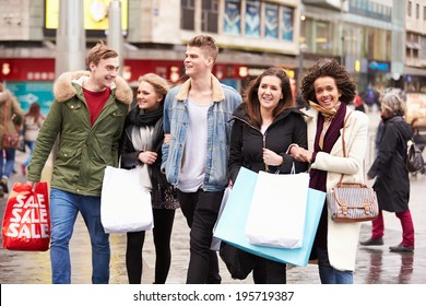 Group Of Young Friends Shopping Outdoors Together