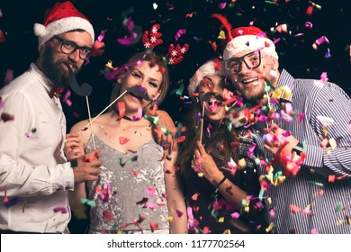 Group of young friends wearing Santa hats having fun at New Year s Eve  Party f5dad7357a28