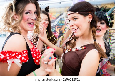 Group of young German women at fasching carnival having costume party