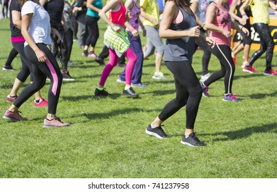 Group of young girls exercising fitness with dancing in the city park