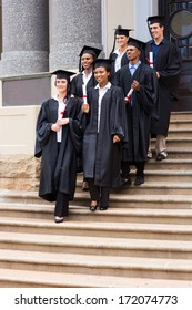 group of young graduates walking down the stairs after ceremony