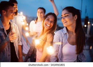 Group of young happy friends having party and fun
