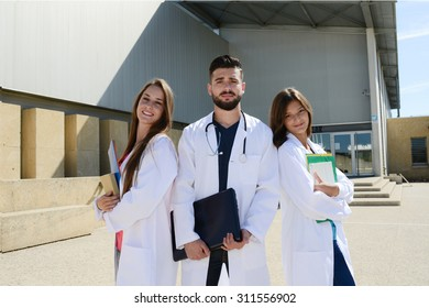 group of young happy medical students boys and girls together on a hospital university campus