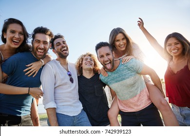 Group of young happy people standing together outside