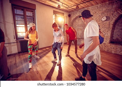 Group of young hip hop dancers dancing in the studio. Sport, dancing and urban culture concept