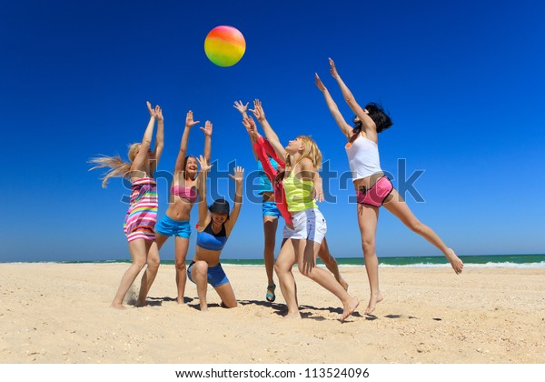 Group Of Young Joyful Girls Playing Volleyball Stock Image