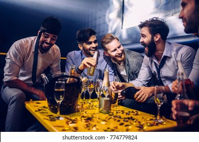 Group of young men drinking at a nightclub