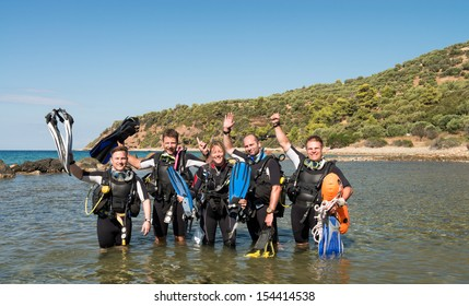 Group of young men and a female learning to dive